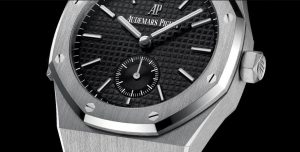 The 42 mm fake Audemars Piguet Royal Oak 26591PT.OO.D002CR.01 watches have black dials.